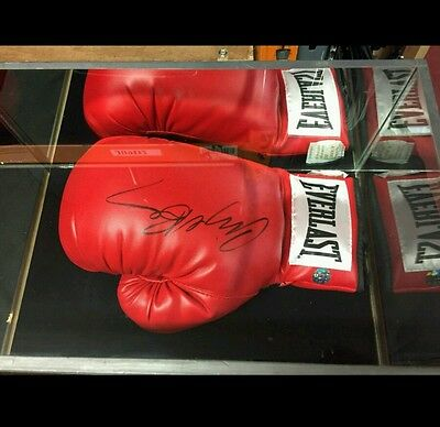 signed boxing glove by boxing legend Nigel benn with Coa