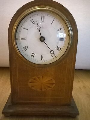 Antique mantel clock. Edwardian with attractive stringing to front. Works well.