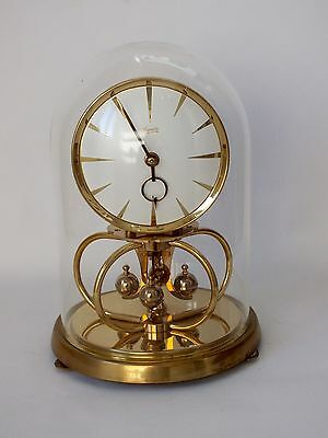 Vintage Kundo Anniversary Torsion Clock with Glass Dome Brass