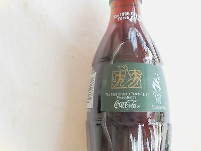 1  antic coca Cola ,from 1996 ,a collectors ite