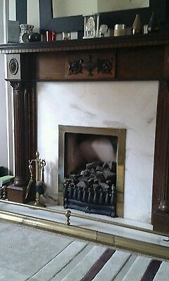 dark oak fire surround with marble hearth and inset
