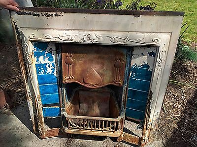 Antique tiled cast iron fireplace insert