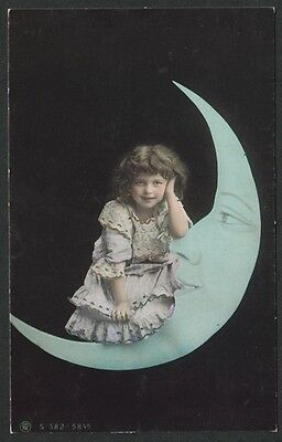 k1949)    EARLY POSTCARD OF A LITTLE GIRL SITTING ON THE MOON