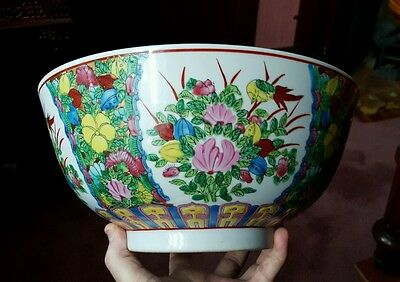 A large vintage oriental hand painted bowl.