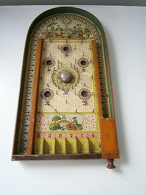 Vintage wooden bagatelle board with Chinese style decoration.