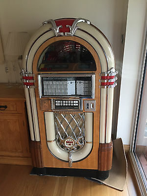 Rowe Ami Bubbler Jukebox out of a home