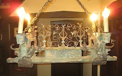 Antique Rustic Wood and Wrought Iron Chandelier.  Wood Carvings. Electrified.