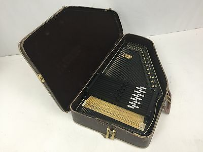 Vintage Autoharp by Oscar Schmidt 15 chord 36 strings in carrying case.