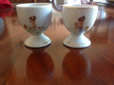 Pair of Vintage ceramic egg cups with gold trim  - marked 'foreign' on base
