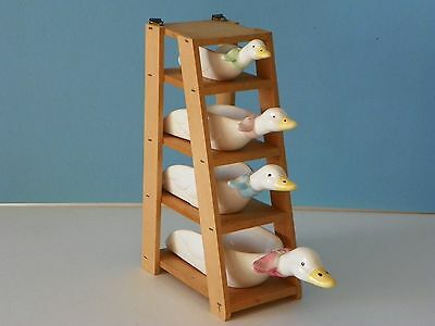Vintage set of four JSNY measuring ducks with wall mount
