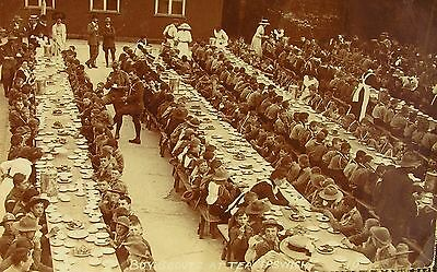 BOY SCOUTS AT TEA IN IPSWICH SUFFOLK c1905 RP PC