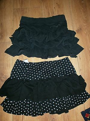 girls 11-12yr, small adult size 6, 2 frilled mini skirts, 1 is pineapple