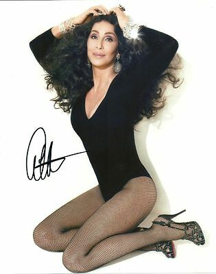 CHER   is a  8 BY 10 INCH AUTOGRAPHED PICTURE WITH A COA