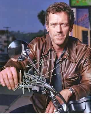 HUGH LAURIE  is a  8 BY 10 INCH AUTOGRAPHED PICTURE WITH A COA