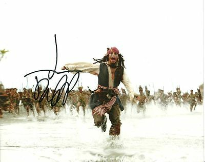 JOHNNY DEPP  is a  8 BY 10 INCH AUTOGRAPHED PICTURE WITH A COA