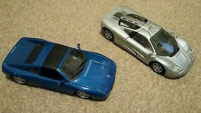 2 model toy cars ferrari and mclaren f1