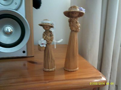 lovely pair of straw lady ornaments