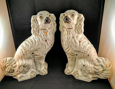 PAIR OF GENUINE STAFFORDSHIRE NO.1 WHITE AND GOLD SPANIEL DOGS. c1860s England