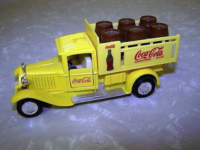 Yellow Coke Delivery Truck