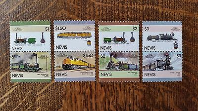 LOCOMOTIVES of the WORLD. NEVIS 1985/1986. 8 MNH stamps. TRAINS / RAIL / LOCOS
