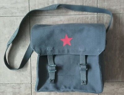 Old army satchel, blue/grey with red star.