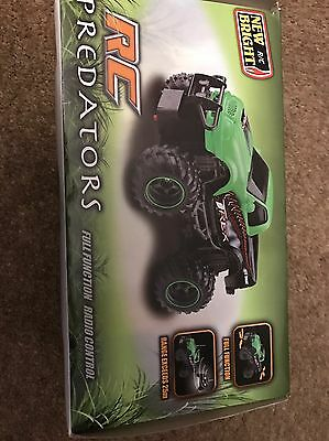 New Bright RC Green Predators radio controlled truck / car - used once in box