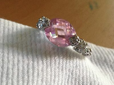 Dress Ring - with huge oval pink cut stone and 4 white stones either side