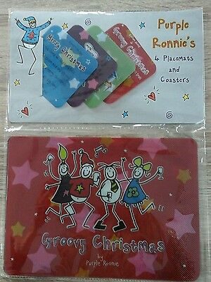 Set of 4 Purple Ronnie Christmas placemats and coasters, new.
