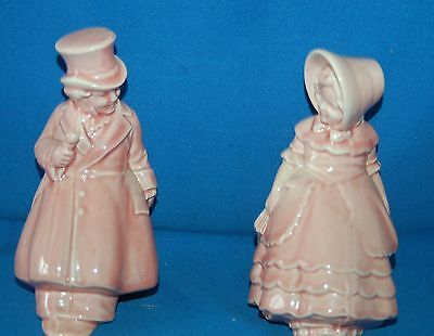 Pair of vintage pink pottery Victorian lady and gent bookends/figures