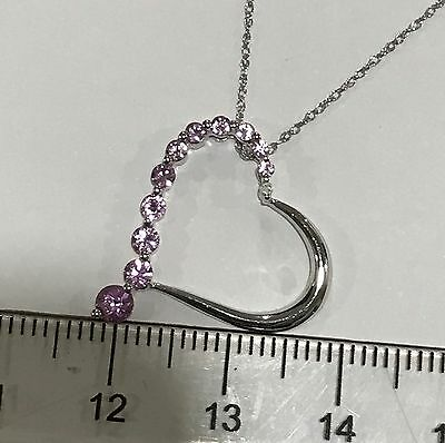 9ct white gold pink sapphire anbd diamond pendant with chain.