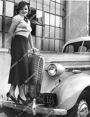 Pic some cute girl on a new 1935 Buick automobile  1319-08