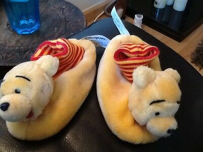 OFFICIAL DISNEYLAND WINNIE THE POOH CHILDS/ INFANT SLIPPERS  .APPROX 16.5 cms