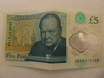 new style 5 pound note, AB, in the seral numbers