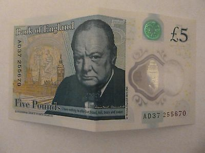 new style 5 pound note, AD, in the seral numbers