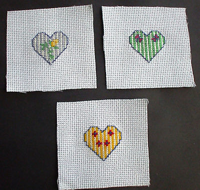 Completed Cross Stitch Hearts x 3
