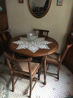 Solid Wood Round Dining Table And Four Chairs