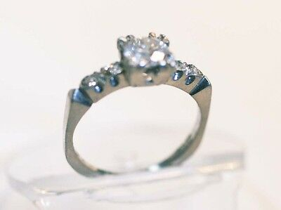 Vintage Platinum Diamond  Engagement ring 0.65 ct VS central stone and  0.20 ct
