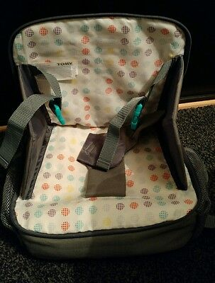 tomy portable booster seat with change bag