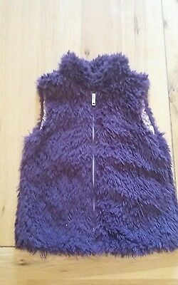Purple furry body warmer. Girls age 7-8.