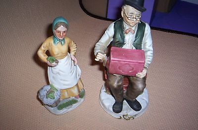 Bisque Figurine Man with musicbox & Lady collecting grapes