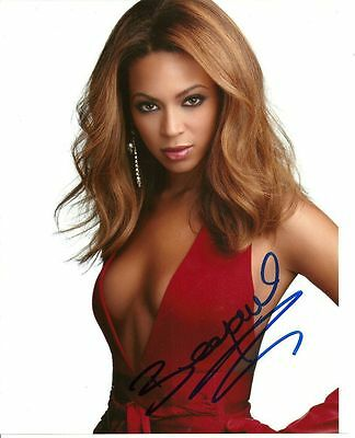 BEYONCE   is a  8 BY 10 INCH AUTOGRAPHED PICTURE WITH A COA