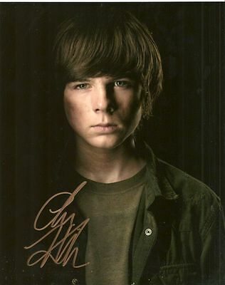 CHANDLER RIGGS   is a  8 BY 10 INCH AUTOGRAPHED PICTURE WITH A COA