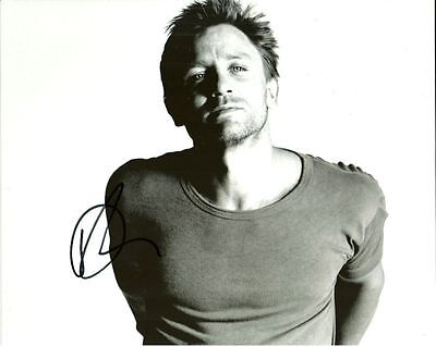 DANIEL CRAIG     is a  8 BY 10 INCH AUTOGRAPHED PICTURE WITH A COA