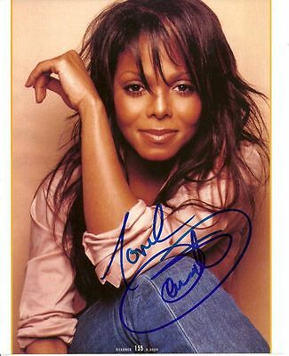 JANET JACKSON    is a  8 BY 10 INCH AUTOGRAPHED PICTURE WITH A COA