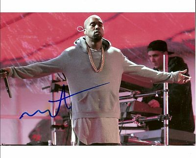 KANYE WEST      is a  8 BY 10 INCH AUTOGRAPHED PICTURE WITH A COA