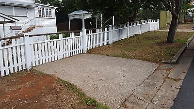 white wooden front yard fence with two gates and mailbox
