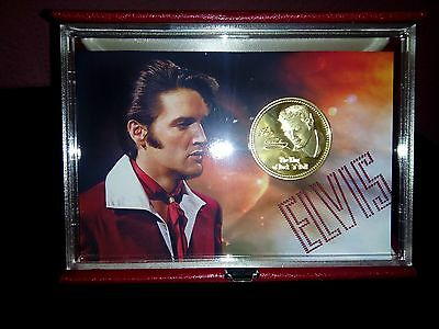 elvis presley gold coin in a folding display case,