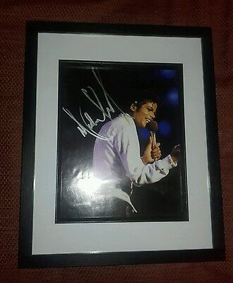 michael jackson authentic signed photo (not a copy )