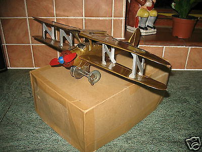 rare folding wing bi-plane pre-war tinplate clockwork sparking tin toy boxed