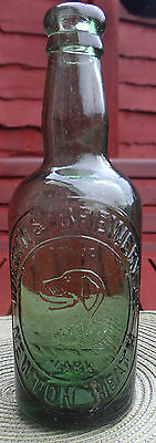 "EMBOSSED:PICTORIAL ""WOLF HOUND"" TRADE MARK BOTTLE Circ:1890.STUNNING BOTTLE"